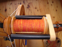 Orange_yarn_on_bobbin_082007_2